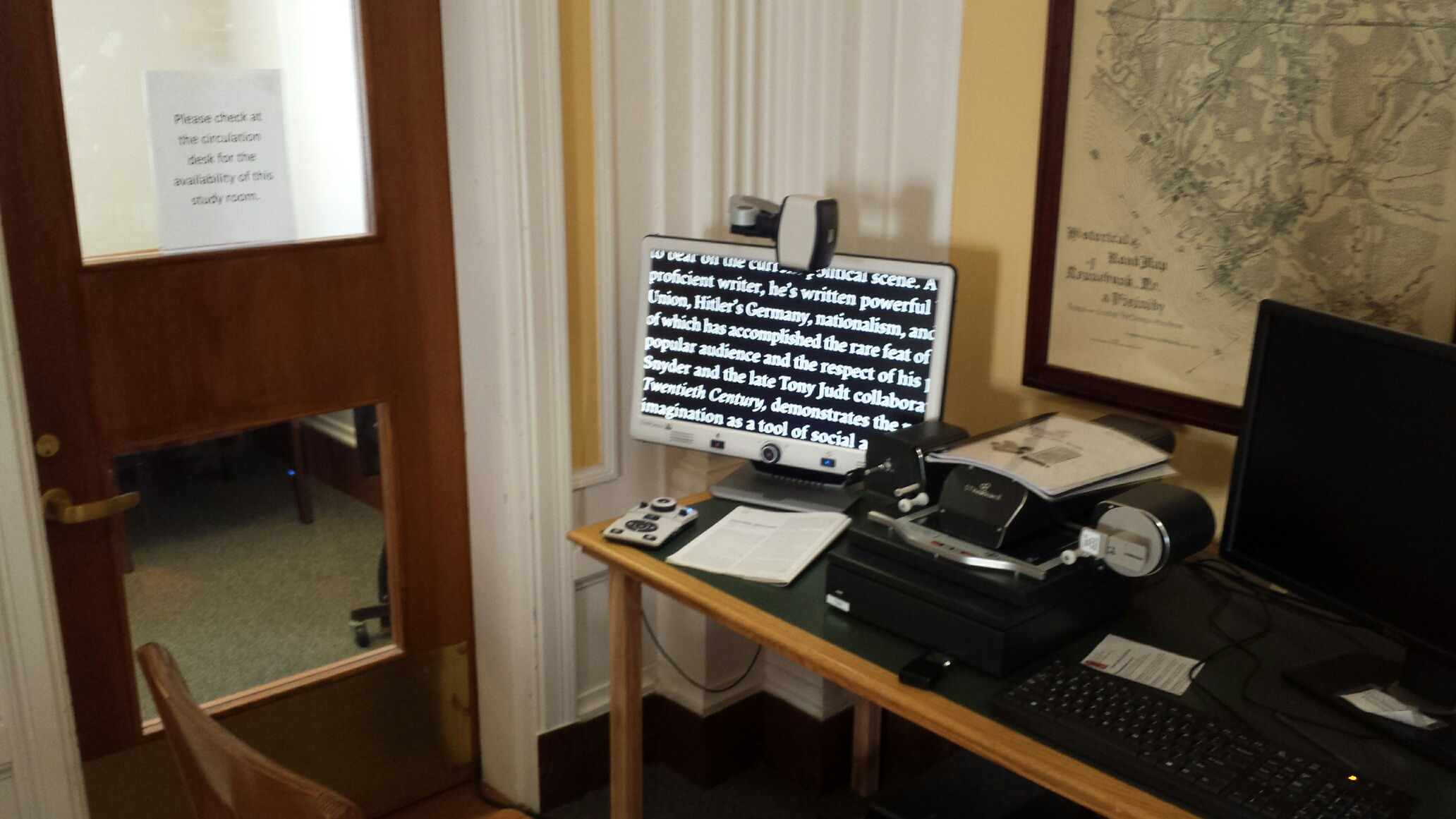 DaVinci video magnifier being used to read in the Kennebunk Free Library