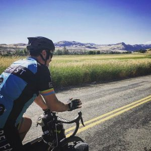 Mike Robertson riding his bike on a road in Idaho